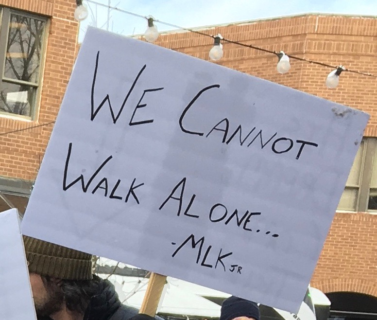 "Sign saying ""We Cannot Walk Alone... - MLK"